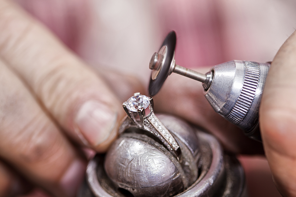 Jeweller polishing the diamond ring